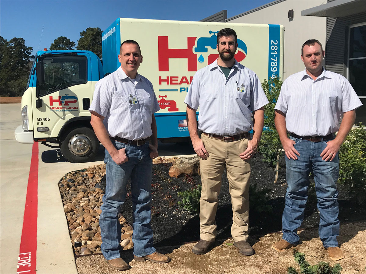 career with heartland plumbing team photo